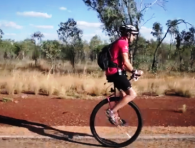 Samuel-Johnson-unicycle-world-record-riding-around-Australia-desert-road-fundraising-Breast-Cancer-Derby-Broome-WA-pink-shirt-2013